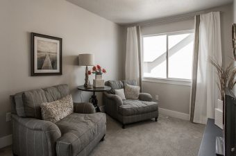 completed and furnished family room built by McArthur Homes