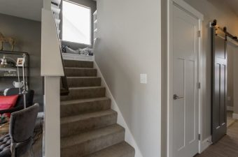 completed and furnished staircase and window nook built by McArthur Homes