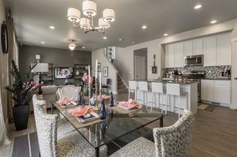 complete and furnished kitchen and living room built by McArthur Homes