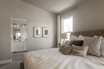 completed and furnished master bedroom built by McArthur Homes