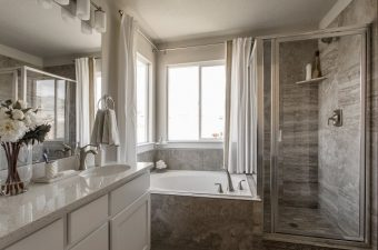 complete and furnished master bathroom built by McArthur Homes