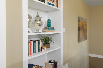completed and furnished book shelf built by McArthur Homes