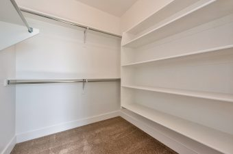 Master closet in the Monterey floor plan built by McArthur Homes