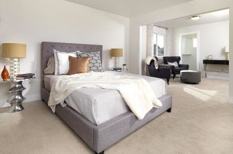 a completed and furnished master bedroom built by McArthur Homes