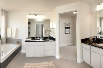 a completed and furnished master bathroom built by McArthur Homes