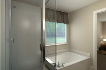a completed and furnished bathroom built by McArthur Homes
