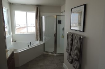 a master bathroom in a home built by McArthur Homes