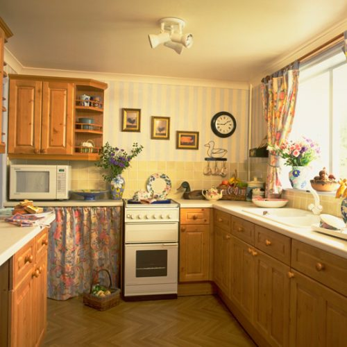 1990s kitchen with orange pine cabinets