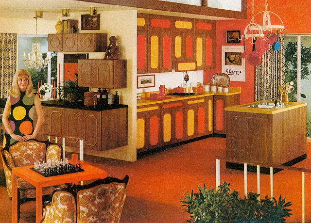 60s home interior with orange walls and carpeting