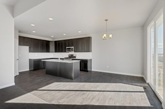 Kitchen/nook in the Merced floor plan by McArthur Homes