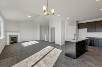 Kitchen/living room in the Merced floor plan by McArthur Homes