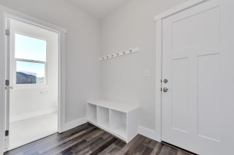 Half bath and mudroom in the Lindsay floor plan built by McArthur Homes