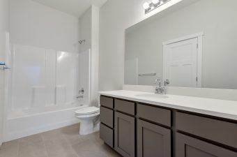 Hall bathroom in the Lindsay floor plan built by McArthur Homes