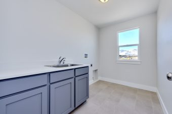 Laundry room in the Lindsay floor plan built by McArthur Homes